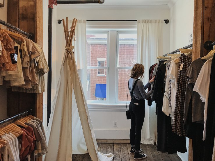 Girl in clothing shop